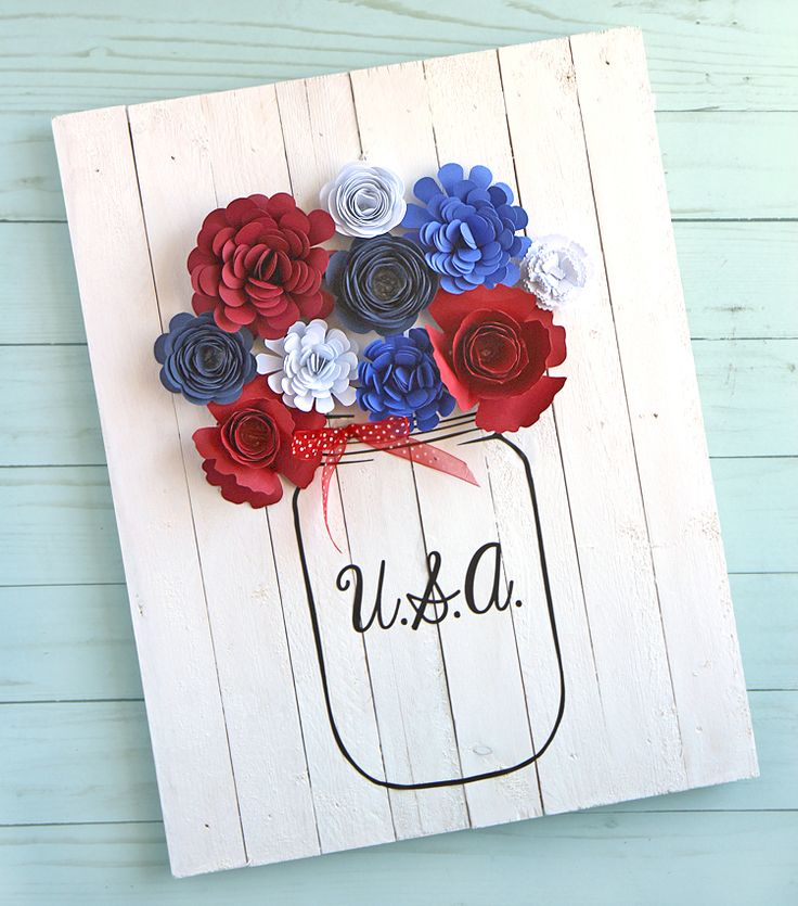 Create this rustic farmhouse style home decor sign with a mason jar filled with rolled paper flowers. Detailed tutorial for every step of this fun, patriotic craft. You'll need craft vinyl and a Silhouette cutting machine project.