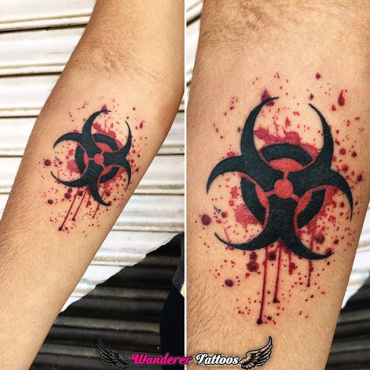 Biohazard symbol with blood-splash  Tattoo by: Anmol Jeswani Wanderer Tattoos Chetakpuri - Gwalior
