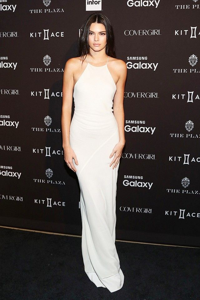 Kendall Jenner wears a white Calvin Klein column gown