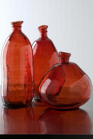 Hand blown bottles look gorgeous in a rich terracotta brown.
