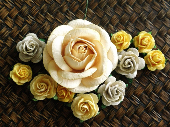 Add a few vintage books under these yellow and taupe paper roses by Moose Art on Etsy.com for an easy centerpiece idea. #wedding