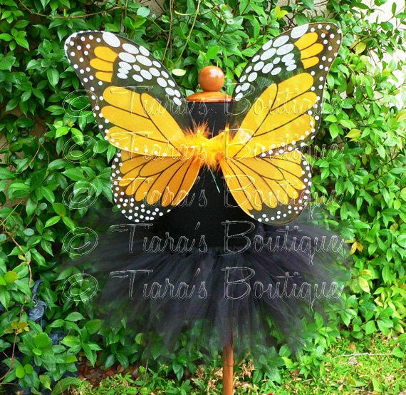 This listing includes a solid black pixie tutu and Monarch Butterfly wings in black and orange. The tutu is made with an angled pixie cut design in an