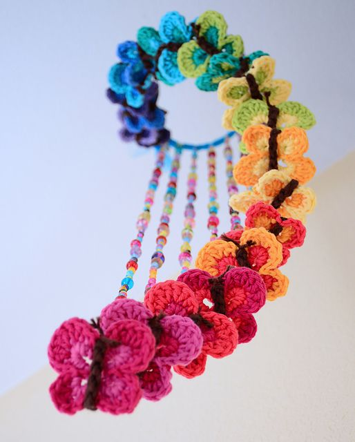 Beautiful rainbow mobile of crocheted butterflies! Found this on Ravelry as a free download.