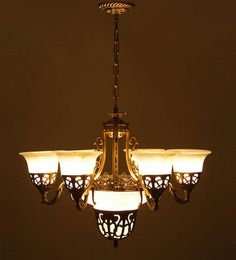 AESTHETICS HOME SOLUTION PORTUGUESE STYLE ANTIQUE ALUMINIUM 9 LAMP SHADES CHANDELIER.  This regal and stylish light fixture gives a royal touch to decor. The unique style and sophistication added to the #chandelier by the finest craftsmen, has the capacity turn your room from drab to exceptional look within few seconds.  www.covetlo.com