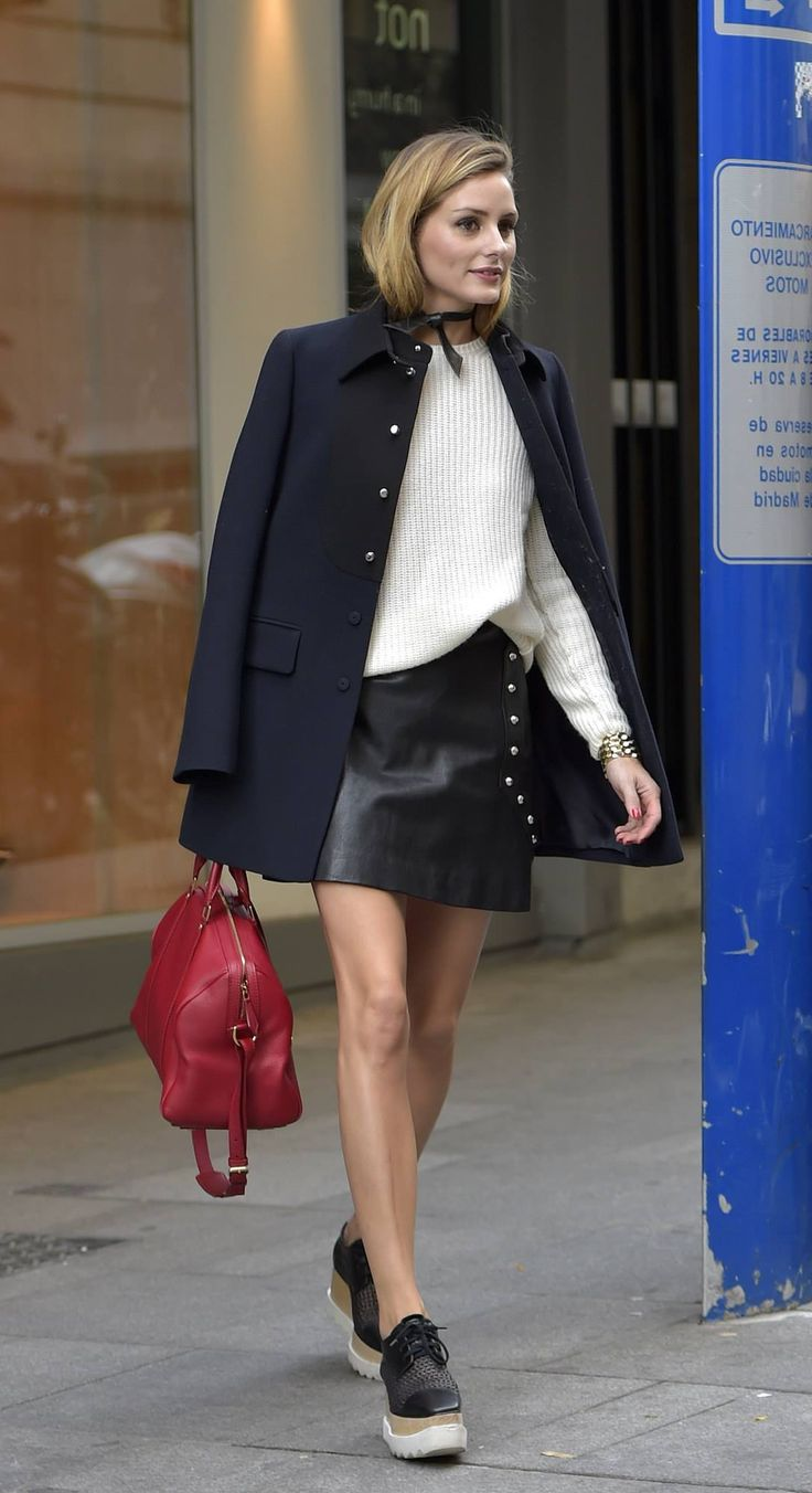 Olivia Palermo in a leather skirt Black coat and beige sweater. I like the red bag too.