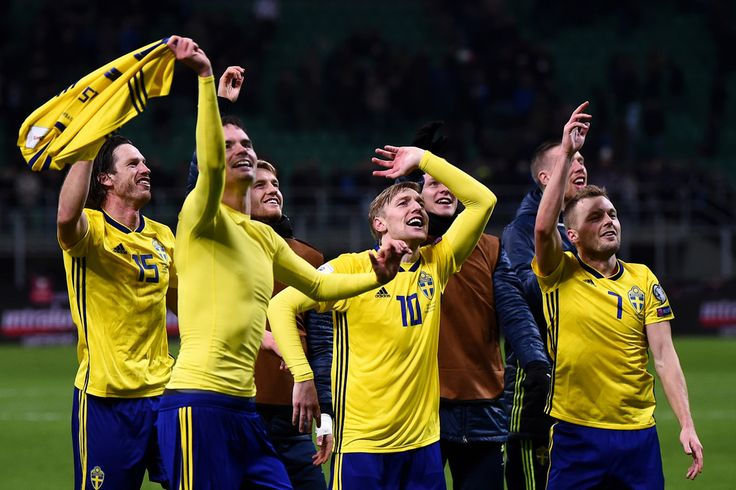 Sweden's players celebrate at the end of the FIFA World Cup 2018 qualification football match between Italy and Sweden, on November 13, 2017 at the San Siro stadium in Milan..Italy failed to reach the World Cup for the first time since 1958 on Monday as they were held to a 0-0 draw in the second leg of their play-off at the San Siro by Sweden, who qualified with a 1-0 aggregate victory