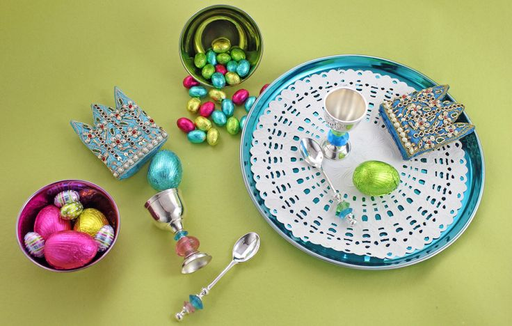 Egg cups, cosies with beaded spoons from Tiffinware.