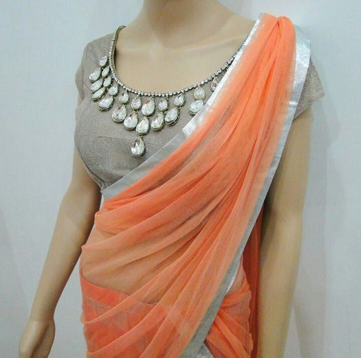 Designer statement sari or saree blouse with embellished stones. Indian fashion.