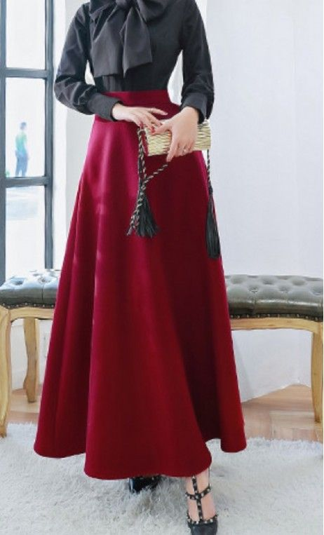 A long winter wool skirt with hidden side pockets matched with a vintage style bowknot blouse available in S-XL