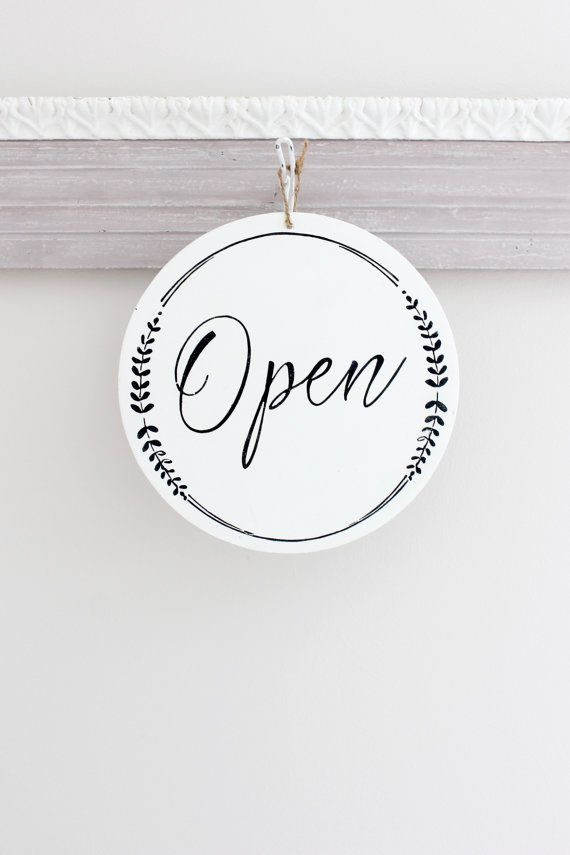 Business/Store Sign: Open/Closed with a whimsical design. THIS SIGN: *Measures 10 round and 1/8 thick. (Very light weight) *Available with jute or white ribbon for easy hanging (Choose in drop down when ordering.) *Sample sign is done in Bright White and Black The front of this sign says Open and on the reverse side Closed. Great sign for any business to hang on the door or in the window. This sign is completely hand painted. Hand painting them adds to the charm of my vintage style signs…