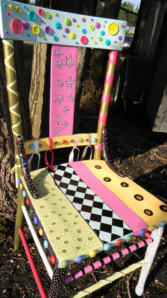 colorful whimsical chair  This is a little too much for me but a cleaver idea