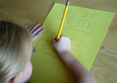 Write down letters and let your child copy them in the box you provide.
