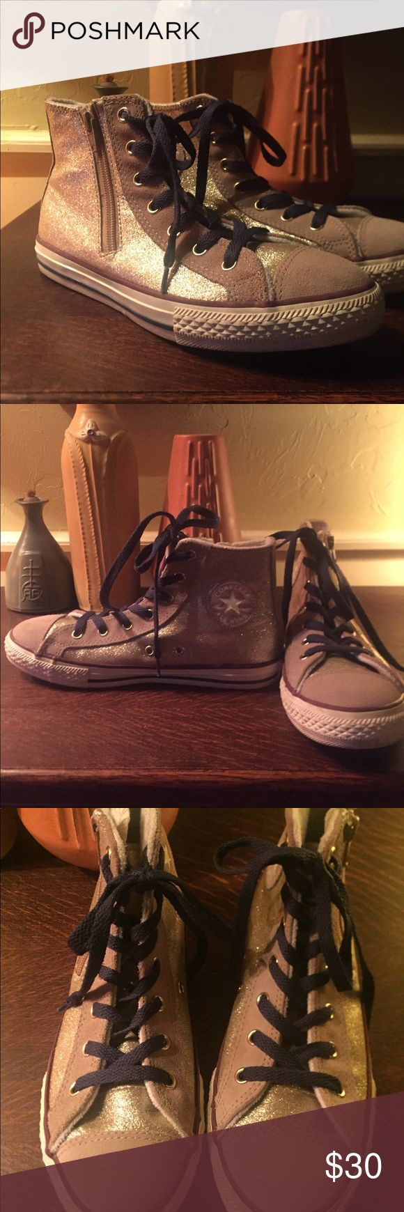 Kids gold glitter Converse hightop with side zip Kids gold glitter Converse hightop with side zip. Gold glitter and buff suede. Navy blue laces. Worn 6 times as a part of a dance team uniform. Excellent condition. Size 4 Converse Shoes Sneakers