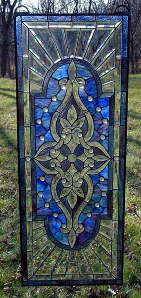stained glass.  Guess I am going to get back to my glass.  This would look so great in the garden.