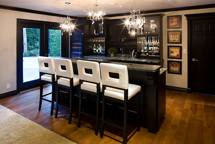 Black cabinets. Bar stools bring brightness to the basement bar [Design: Tavan Group]