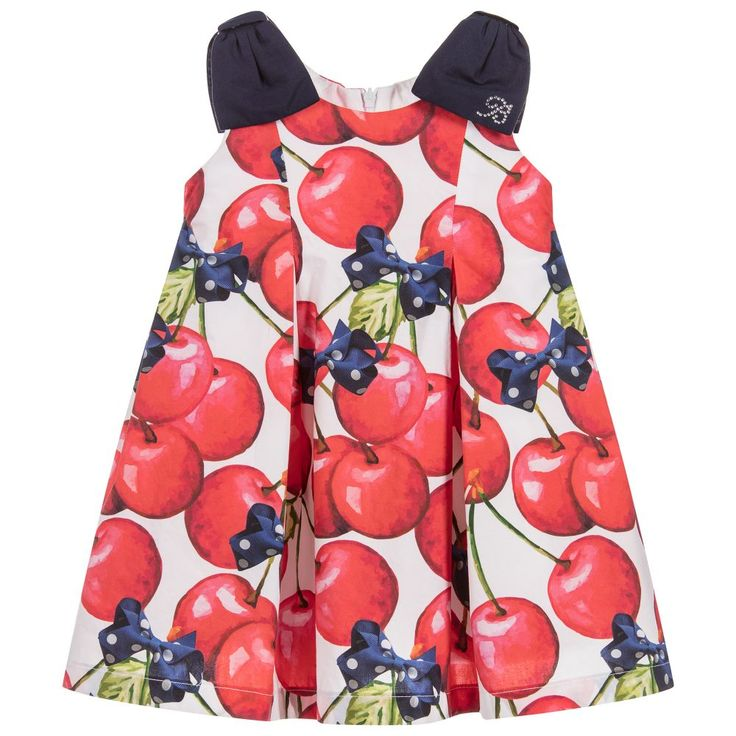 This pretty dress by Balloon Chic has a lovely summery print of red cherries and navy blue spotty bows. It is made from lightweight cotton and is fully lined, so girls will feel cool and comfortable on warmer days. There are inverted pleats on the skirt which adds fullness and the shoulders have cute navy blue bows.