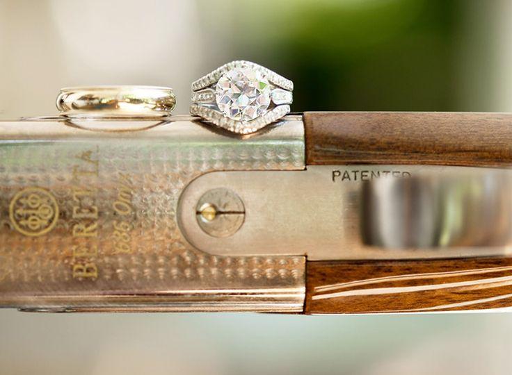Wedding rings photographed on over under double barrel Berretta shotgun.