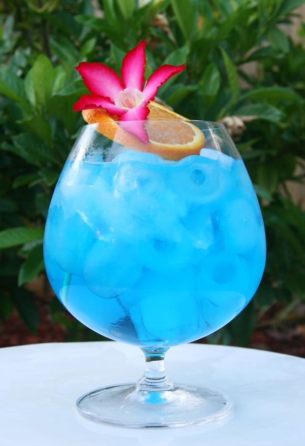 BLUE OCEAN    1 oz. vodka  1/2 oz. blue curacao  1/3 oz. grapefruit juice  1-2 splashes simple syrup    Add all ingredients to a shaker filled with ice; shake,  then strain and serve either straight up in a martini glass  or over ice. Garnish with an orange slice & tropical flower.