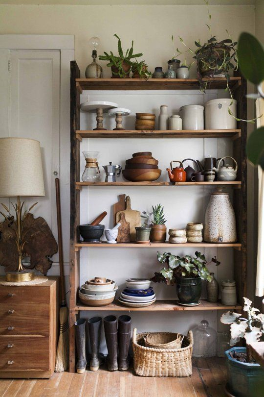 Caught our eye: a gorgeous collection of thrifted kitchenwares on a hand-built shelf.
