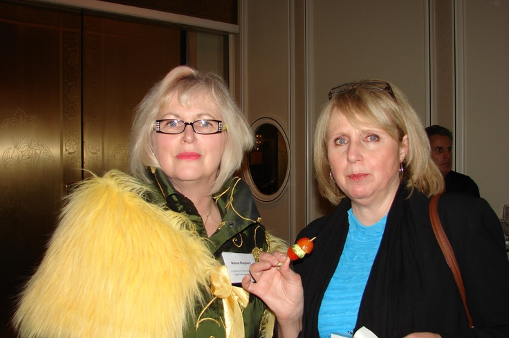 Norma Shephard with sister Elizabeth DeLuca. No hat? The faux monkey fur shawl makes up for it.