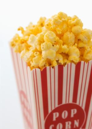 Cheese Popcorn that doesn't use artificial cheese powder. Just real ingredients like butter and grated Cheddar cheese. Make it for your next movie night or afternoon snack!