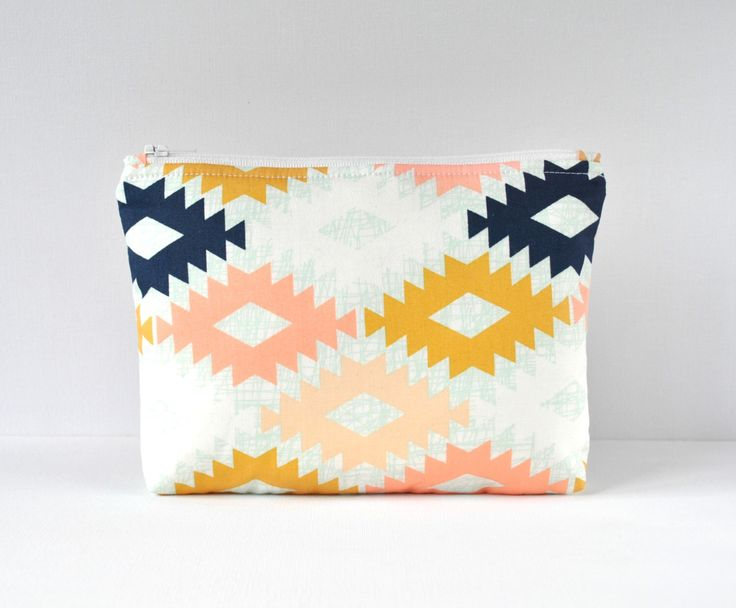 Padded woman's Aztec style travel make up pouch cosmetics bag in pink,gold,navy blue and cream in large. by CuriousMissClay on Etsy https://www.etsy.com/listing/205655602/padded-womans-aztec-style-travel-make-up