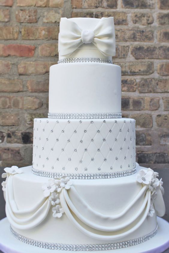 Classic white and silver studded wedding cake; Featured Cake: Alliance Bakery