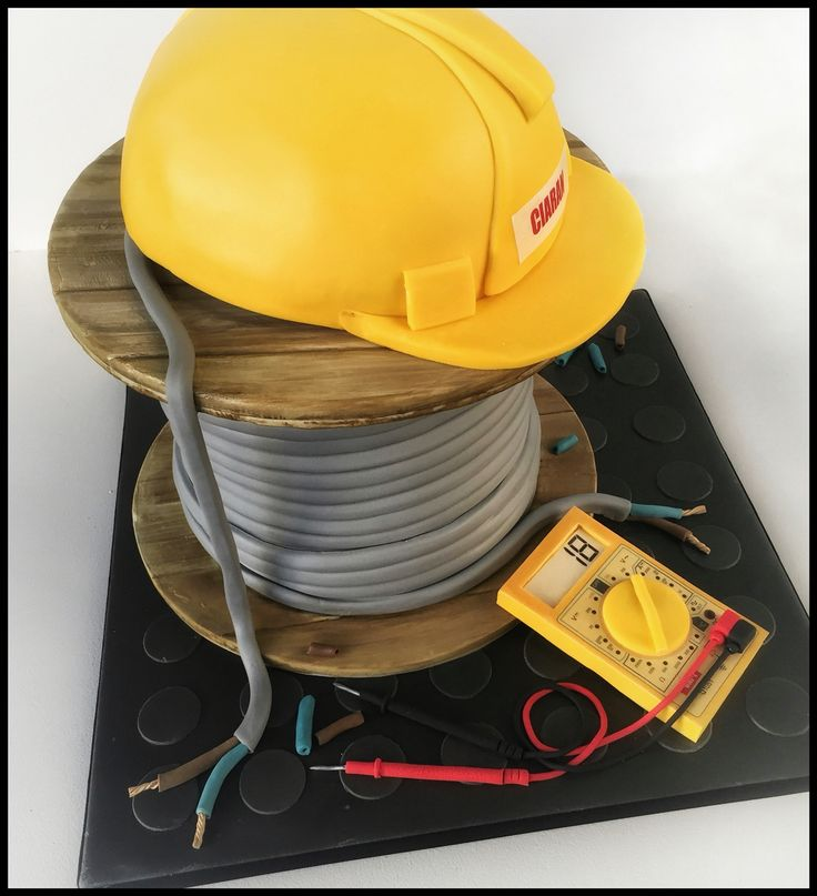 Electrician's birthday cake. Hard hat on cable drum.