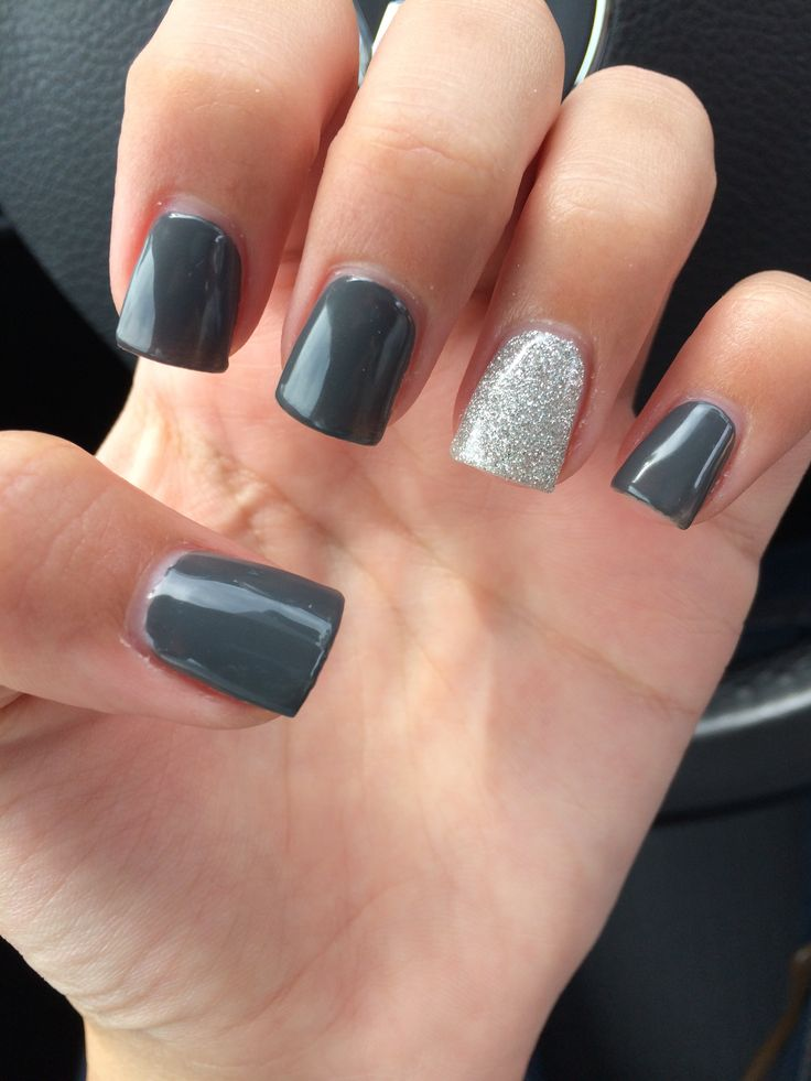 Beautiful charcoal grey manicure with silver glitter accent nail!! This is absolutely stunning! I did something similar, but with a lighter grey polish, and I added clear nail gems near the cuticles. I TOTALLY think grey is the new black!! This is so chic!!!