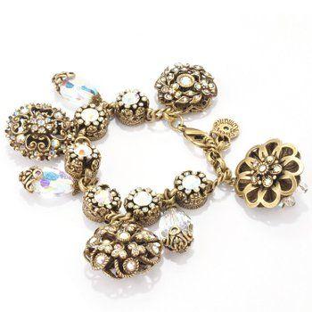 This Sweet Romance Aurora Superlativo Chunky Charms bracelet is a veritable sampler of vintage American metalcraft