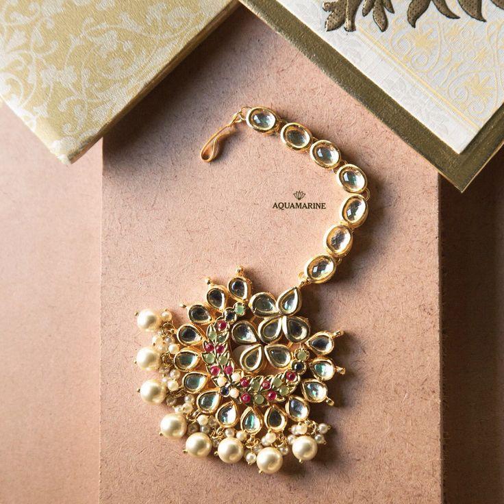 Finely detailed maangtika enamelled with kundans and stones takes the glam quotient up a notch. Available at Aquamarine. #aquamarine_jewellery #maangtika #wedding #beautifull #indianjewellery #stones #weddingjewellery #pearls #gold #accessories #mumbai #india #aquamarinejewellery