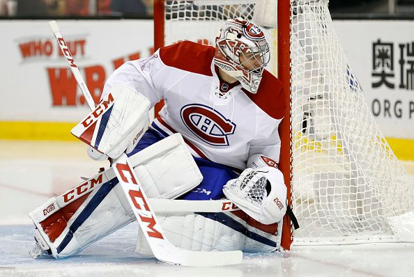 Montreal Canadiens goalie Carey Price watches a puck in the corner The Montreal Canadiens defeated the Boston Bruins 42 in a regular season NHL game...