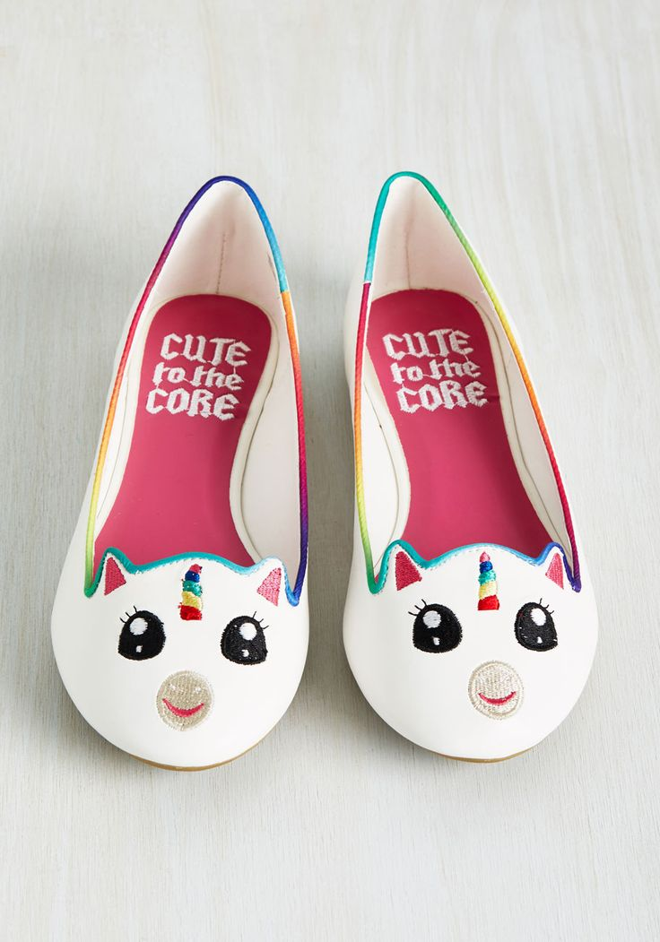 And now for the world's cutest flats on which to feast your eyes! Starring a sweet-as-can-be embroidered unicorn face supported by rainbow piping and a matching horn, these white, faux-leather kicks are a pair your street style followers would gladly pay admission to see.