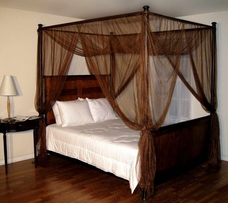 Four-Poster-Bed-With-Curtains-And-Wood-Table.