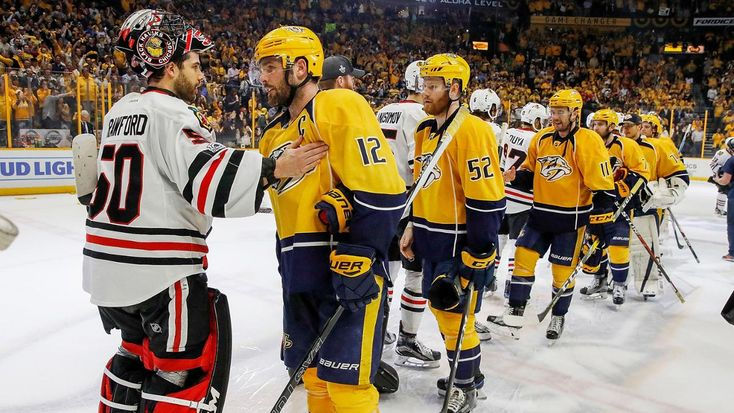 Nashville, TN - APRIL 20: Mike Fisher #12 of the Nashville Predators shakes hands with Corey Crawford #50 of the Chicago Blackhawks after a 4-1 series win in Game Four of the Western Conference First Round during the 2017 NHL Stanley Cup Playoffs at Bridgestone Arena on April 20, 2017 in Nashville, Tennessee.
