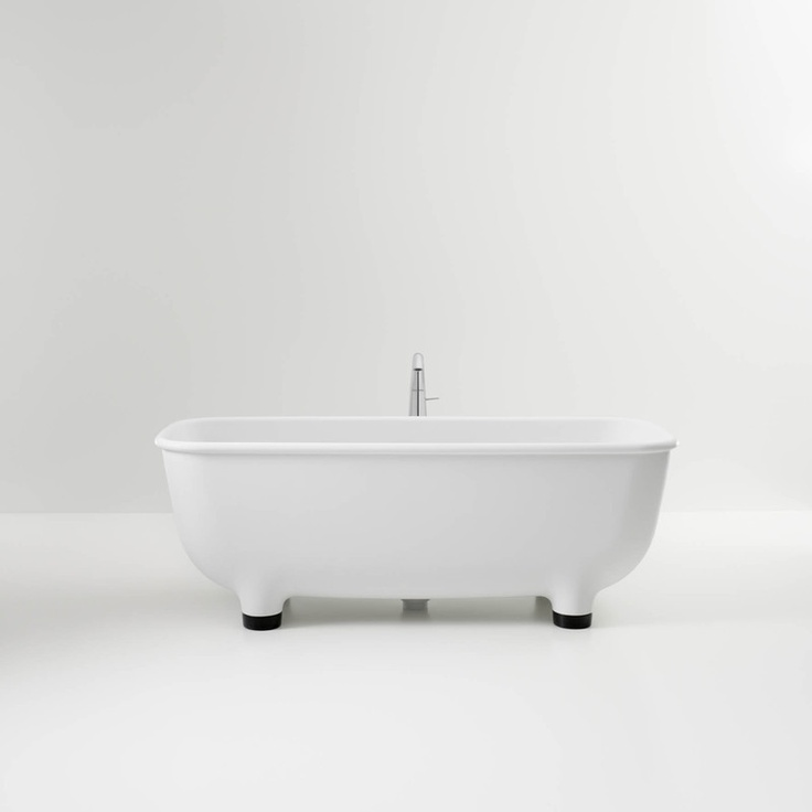 Crafted from CRISTALPLANT® for a matte, stone-like finish and long, stylish life. Soft to the touch, non-porous, hygienic and restorable. Adjustable resin feet and an integrated pop-up waste with CRISTALPLANT® waste cap combines beauty with function.