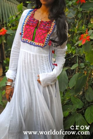 Description : Beautiful White Anarkali with 36 kali and with one of a kind kutchi work on the neck and tie ups on the waist Fabric : Mul Mul Color : White  OUR DRESSES HAVE GOOD 2 MARGIN FROM BOTH THE SIDES IF YOU PUT ON OR SOMETHING THIS DRESS WONT MAKE YOU PUT DOWN :)