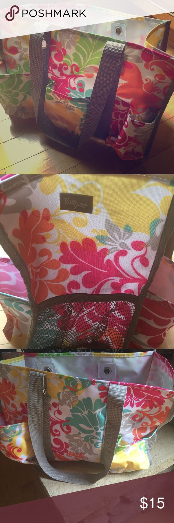 Thirty one utility tote 16 x 6.  3 outer pockets on one side , 2 outer pockets on the other and one mesh pocket at each end. Pretty spring print. EUC   One big compartment inside Thirty One  Bags Totes