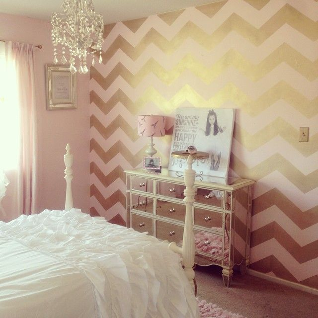 A blush pink and gold Chevron Allover stenciled accent wall in a girl's room by Maria. http://www.cuttingedgestencils.com/chevron-stencil-pattern.html