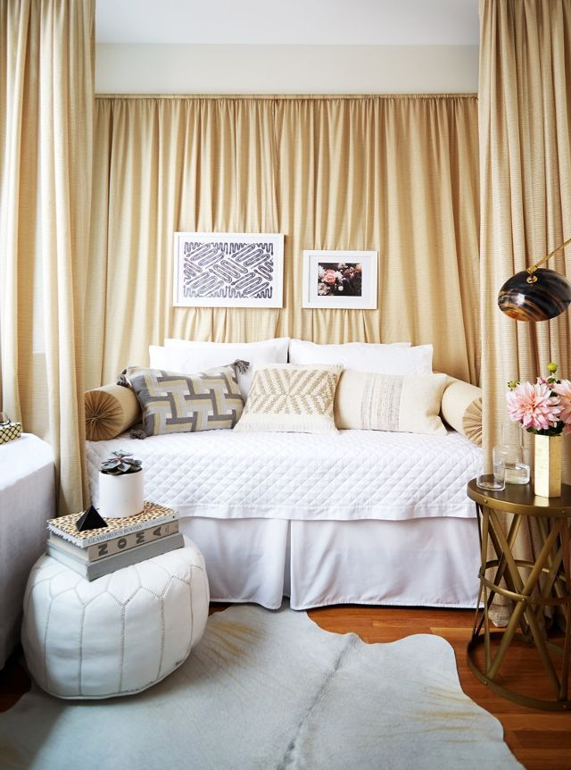 In this little Manhattan pad, the designer used tension rods to separate the bed from the rest of the apartment. In a rental, this is a great solution that doesn't require a drill (or losing a...