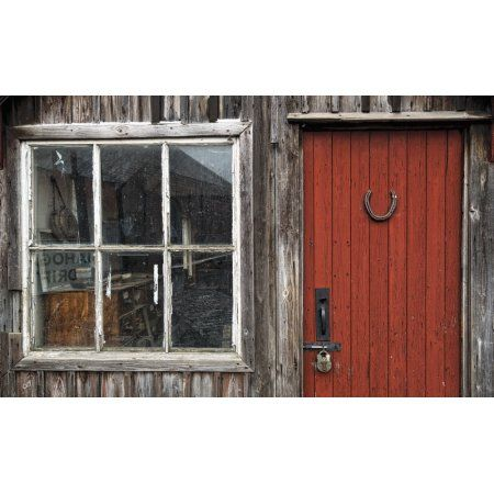 Wooden building with red painted door padlock and window Beamish Durham England Canvas Art - John Short Design Pics (19 x 12)