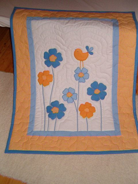 Flowery baby blanket  Appliqued Baby Quilt by Customquiltsbyeva.  @Bekki Tallon , if you ever have a girl, this is the one i'm making!!!