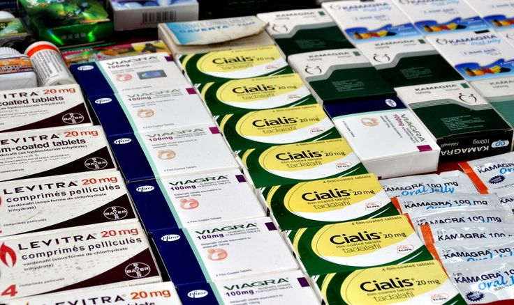 A display of sexual enhancement drugs including Levitra, Viagra, and Cialis are sold by street vendors on Sukhamvit Road at Nana in Bangkok, Thailand.