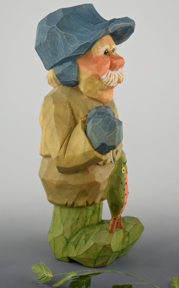 Lars is an avid fisherman, summer and winter. Even in the deep freeze of Nordic winters in his ice house or the rain and rough waters on the fjords in summer, Lars wears a smile and has a twinkle in his eyes. He stands 5.5 inches (14 cm.) tall and was lovingly carved from Northern basswood. His rainbow trout measures 1.5 inches (nearly 4 cm) long and is also carved from basswood. What a catch
