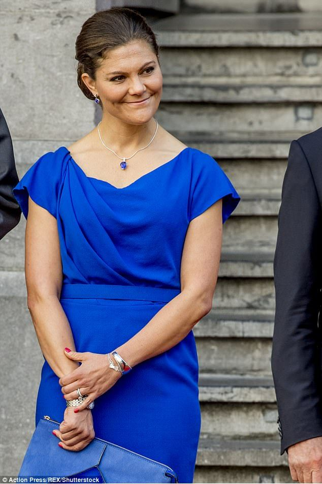 Her vibrant blue dress had a flattering cowl neck and a demure knee length hem