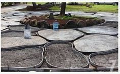 DIY concrete pavers looking like flagstone. Love this for our back/side yard where I want to do a hard scape.