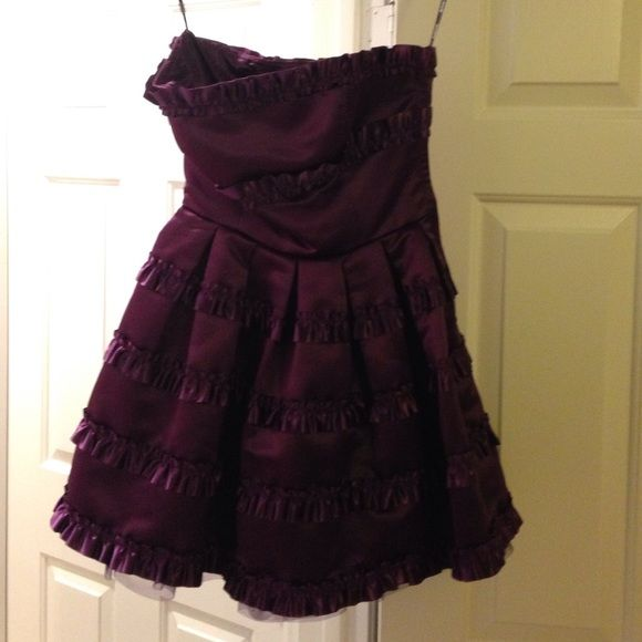 Purple cocktail dress, ruffles xoxo Purple satin strapless dress, ruffle every few inches, fit & flare, purple tulle underneath. Worn once Betsey Johnson Dresses Mini