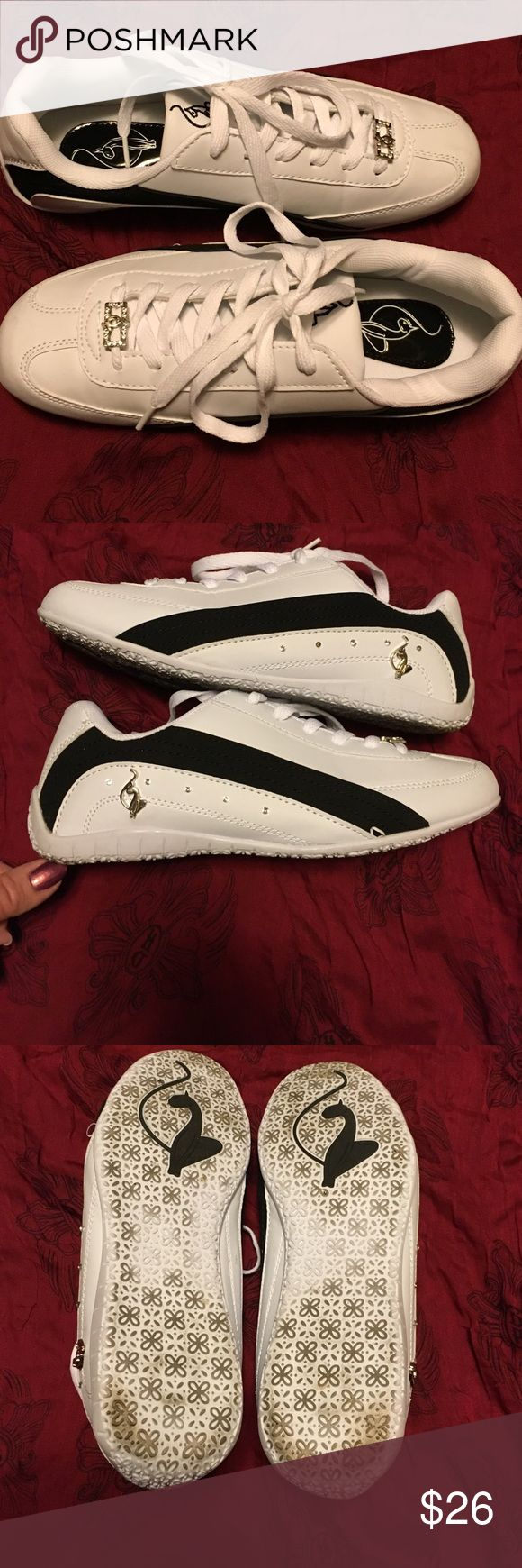 Baby Pfat Sneakers. Size 8. Cute tennis shoes! White with black stripe. Worn a couple times. Nice shape! Note on last pic 2 small crystals missing. Price reflects. Baby Phat. Size 8. Baby Phat Shoes Sneakers