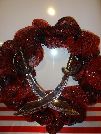 Arrr ye ready to party like a pirate? Welcome ye mateys with a pirate sword door wreath. Enter at ye own risk!