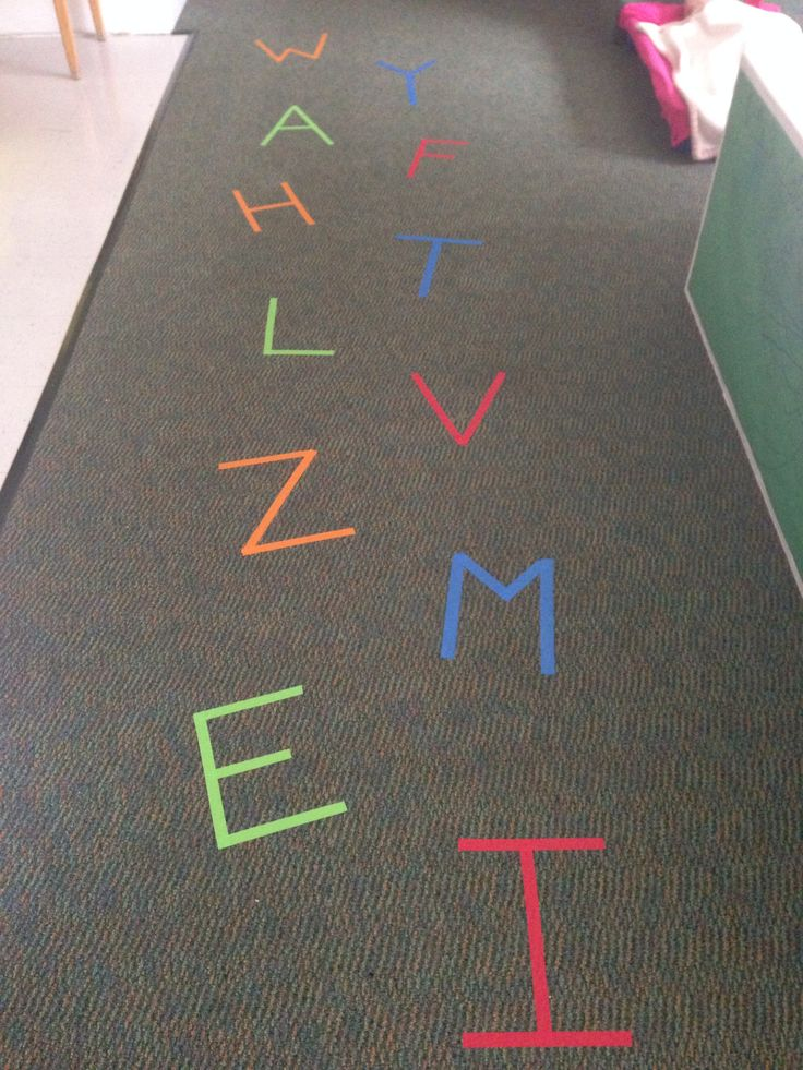 Random letters on the floor made with colored tape! Great